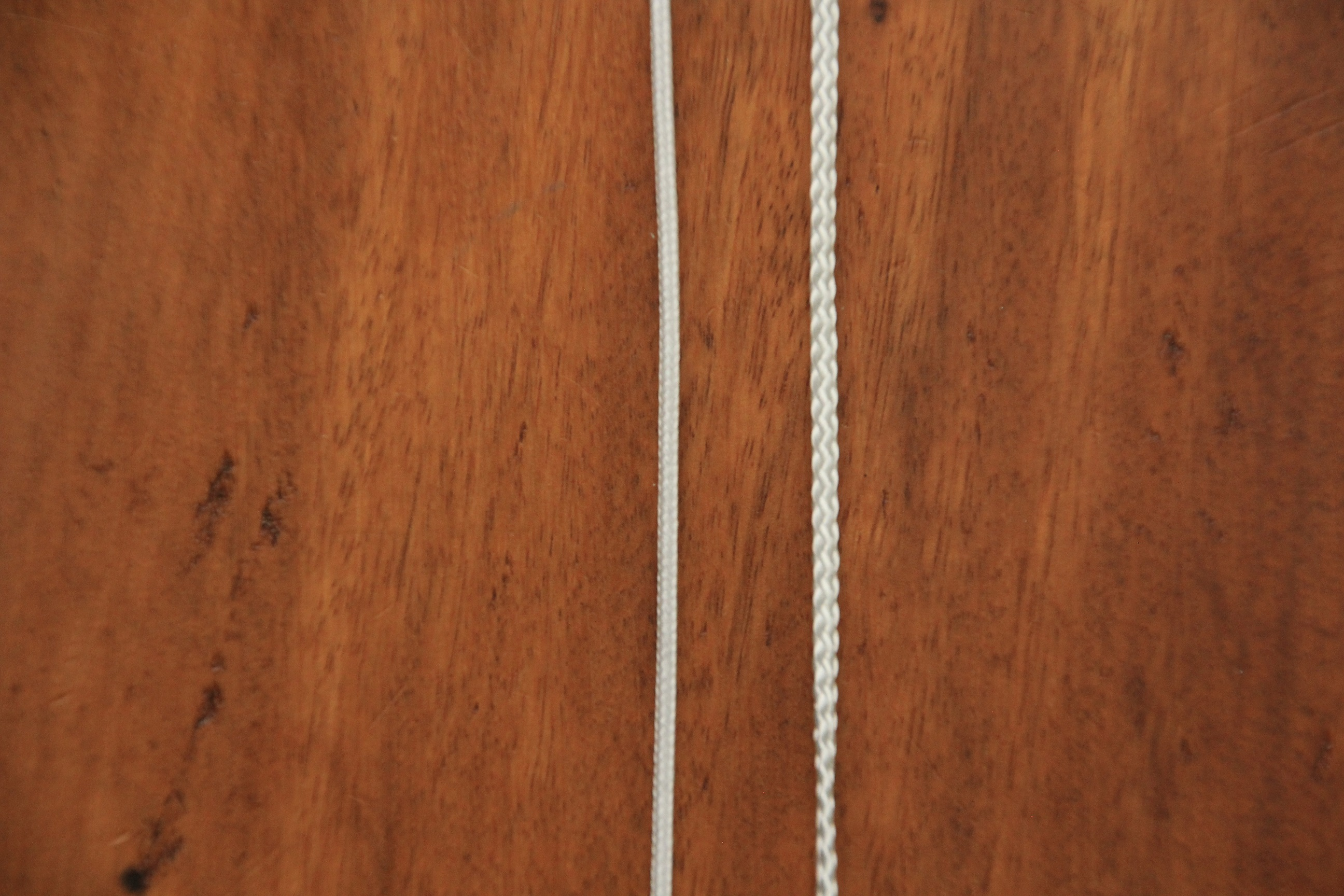 Image of a thinly braided line on the left and a heavy braided line on the right