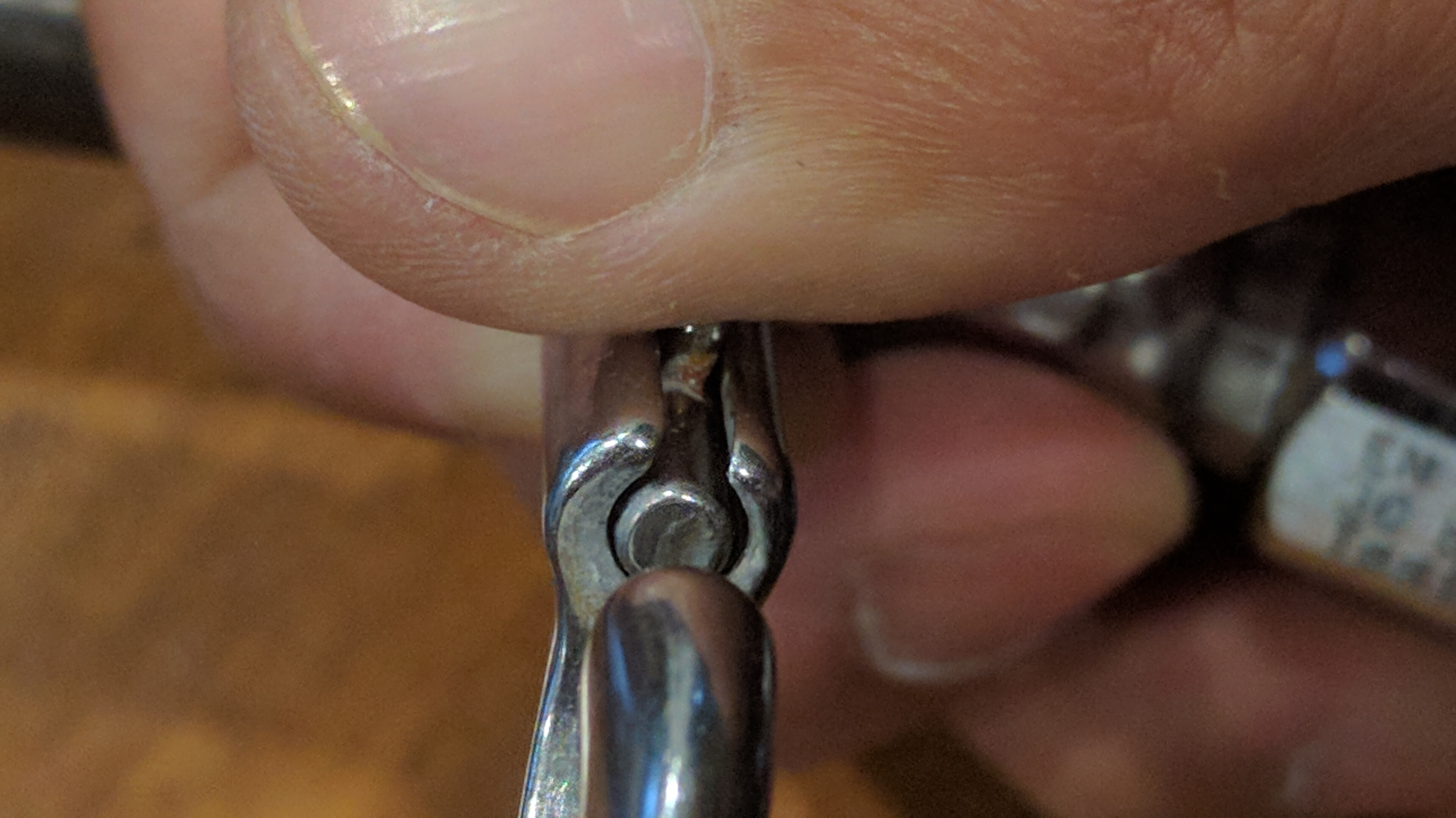 The proper way to hold a bolt snap open.